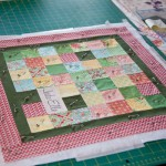 Postage Stamp Quilted Cushion completed
