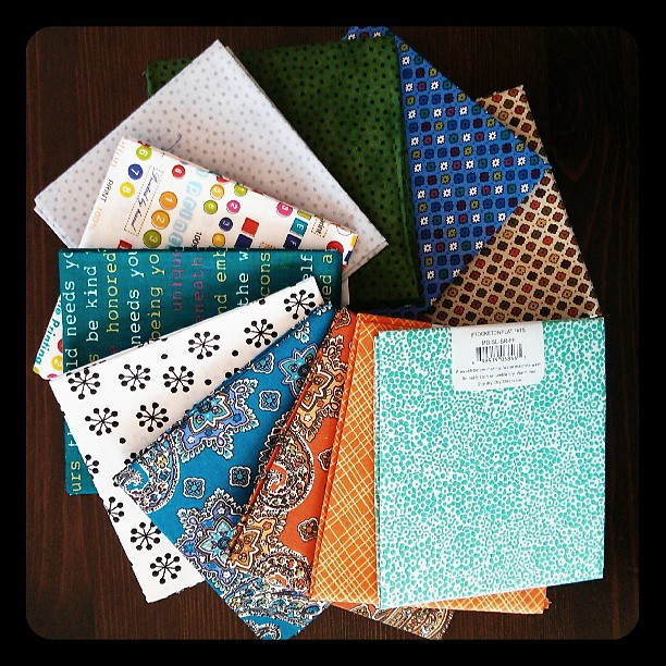 A frenzy of fat quarters at $1 each. I had trouble stopping at 11, and went back for more a couple of days later!