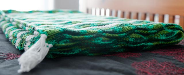 Ripple Crochet blanket in green and white.