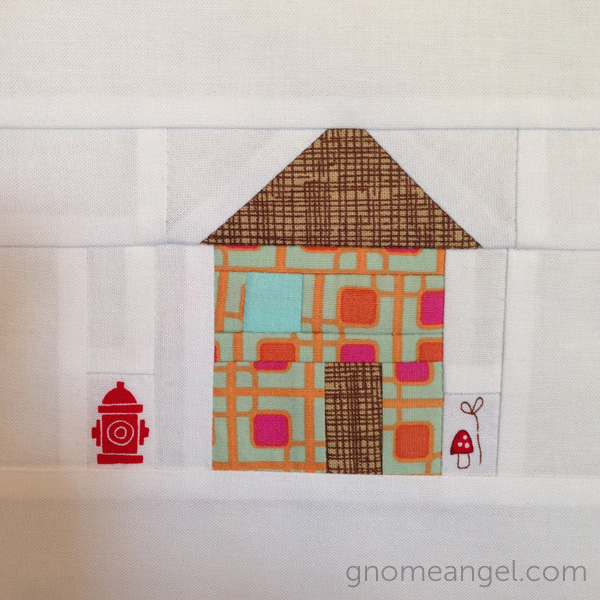 Angie's adorable little house. LOVE the fire hydrant detail!