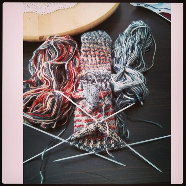 Spider wrestling aka knitting socks on dpns. Using up 2 half balls of wool.