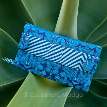 Della Wallet Clutch with directional fabric.