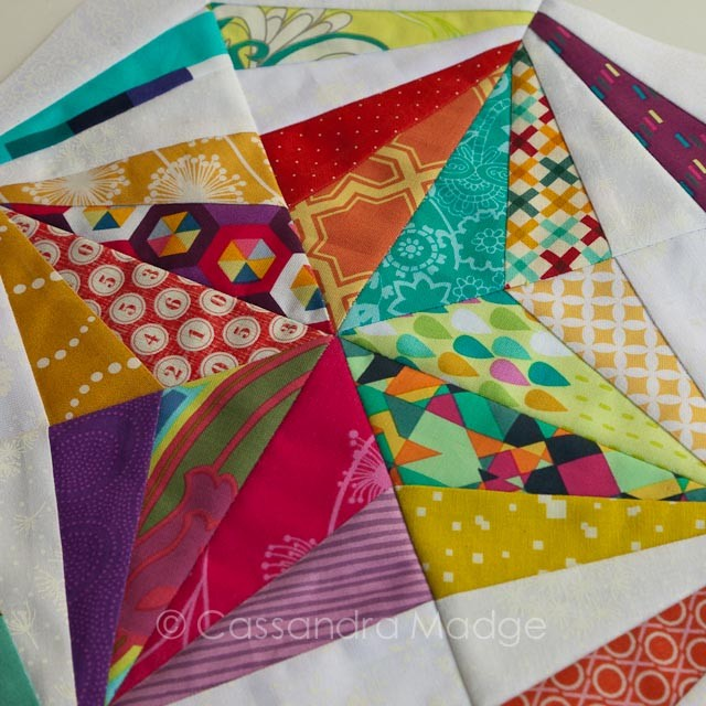 Bright scrappy paper pieced star block