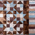 Stars and Bubbles on the quilt frame